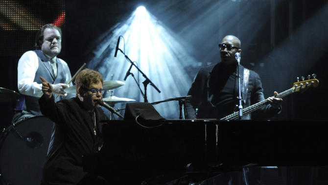"""Elton John performs """"Streets of Philadelphia"""" at the MusiCares Person of the Year tribute honoring Bruce Springsteen at the Los Angeles Convention Center on Friday Feb. 8, 2013, in Los Angeles. (Photo by Chris Pizzello/Invision/AP)"""