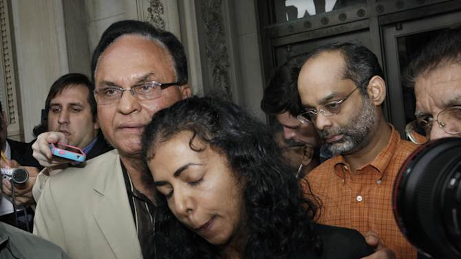 Ravi Pazhani, right, watches his wife Sabitha Ravi, center, as she is consoled by Satish Mehtani while talking outside the New Jersey Statehouse about her son, Dharun Ravi, in Trenton, N.J., Monday, May 14, 2012. Supporters rallied on behalf of Dharun, the former Rutgers University student convicted of bias intimidation for using a webcam to see his roommate kissing another man. The case garnered national attention because his roommate, Tyler Clementi, killed himself in September 2010, just days after the spying. (AP Photo/Mel Evans)