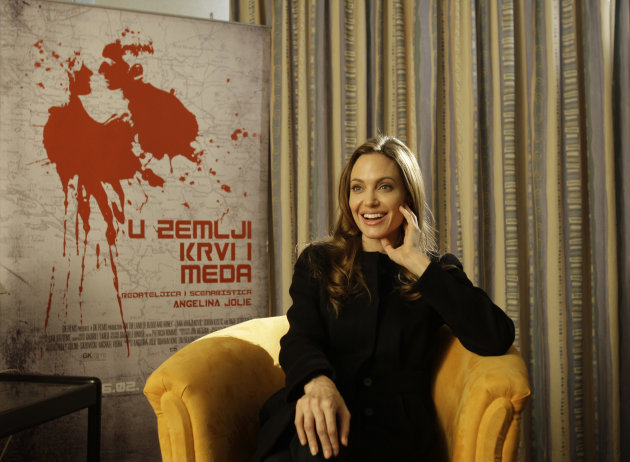 "Actress Angelina Jolie answers question during an interview with Associated Press, in Sarajevo, Bosnia, on Wednesday, Feb. 15, 2012. Angelina Jolie visited Bosnia for the premiere of her movie ""In the land of Blood and Honey"". Angelina Jolie said Wednesday working as a director has rekindled her love for the film industry, even if it was something of a personal artistic rebellion. Jolie told The Associated Press in Sarajevo that she was starting to feel ""disheartened"" and uninspired by her acting roles. She knew she wanted to use film as a medium to deal with weighty matters, such as human rights abuses. (AP Photo/Amel Emric)"