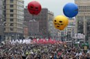 Opposition supporters gather for a protest rally in Moscow, Saturday, Sept. 15, 2012. Thousands of protesters marched across downtown Moscow on Saturday in the first major rally in three months against President Vladimir Putin, while defying the Kremlin's ongoing efforts to crackdown on opposition. Color balloons with the words Freedom to Pussy Riot refer to the three members of the punk band Pussy Riot sentenced to two years in prison for performing an anti-Putin song inside Moscow's main cathedral. (AP Photo/Mikhail Metzel)