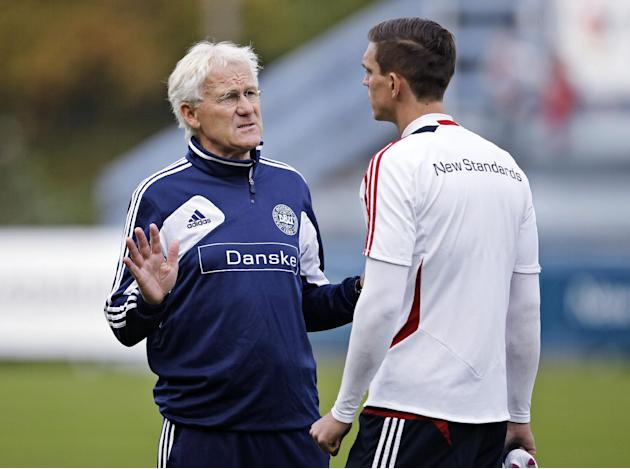 Denmark's coach Morten Olsen talkes to Danish captain Daniel Agger during a traning session with the Danish National Soccer team, Monday Oct. 7 2013 at Helsingor Stadium, Denmark. Denmark plays a deci