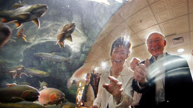 Sen. Susan Collins, R-Maine, and Interior Secretary Ken Salazar look at an aquarium containing trout and salmon during a visit to the L.L. Bean retail store, Thursday, Aug. 18, 2011, in Freeport, Maine. Salazar is in Maine to highlight the economic benefits behind outdoor recreation and emphasize the importance of continued investment in conservation of parks and other public lands. state recreation and offshore wind power research. (AP Photo/Robert F. Bukaty)