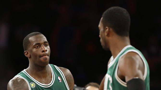 Boston Celtics forwards Brandon Bass (30) and Jeff Green (8) celebrate their 92-86 win over the New York Knicks in Game 5 of their first-round NBA basketball playoff series at Madison Square Garden in New York, Wednesday, May 1, 2013. (AP Photo/Kathy Willens)