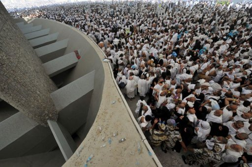 "Muslim pilgrims throw pebbles at pillars during the ""Jamarat"" ritual"