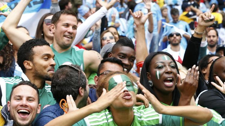 Nigeria fans cheer after the 2014 World Cup Group F soccer match between Argentina and Nigeria at the Beira Rio stadium