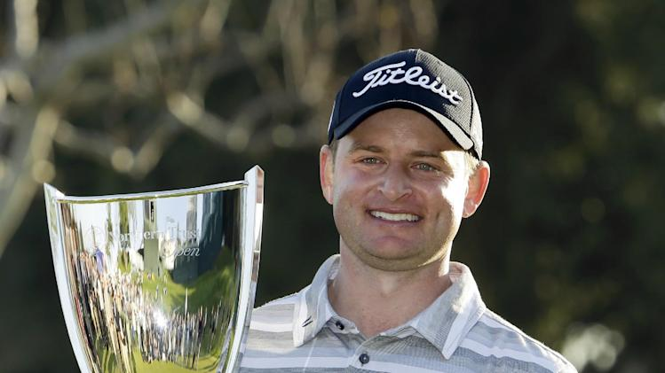 John Merrick holds the winner's trophy after his victory in the Northern Trust Open golf tournament at Riviera Country Club in the Pacific Palisades area of Los Angeles on Sunday, Feb. 17, 2013. (AP Photo/Reed Saxon)