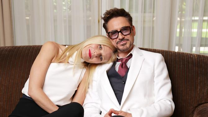 "In this Monday, April 22, 2013 photo, Gwyneth Paltrow and Robert Downey Jr. pose for a portrait at the Four Seasons Hotel in Los Angeles. There's something of the old married couple about Paltrow and Downey Jr., though they're married to other people. They're cozy and comfy sitting down together for an interview, shifting easily between talking about their Marvel Studios superhero sequel ""Iron Man 3,"" chatting up each other's career, family, and trading small talk. ""Iron Man 3"" releases in the USA on May 3, 2013. (Photo by Eric Charbonneau/Invision/AP)"