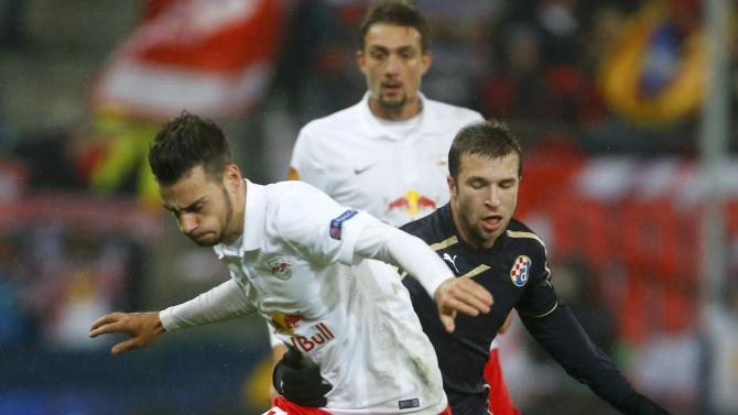 Salzburg's Ankersen Ulmer is challenged by Dinamo Zagreb's Antolic in Europa League soccer match in Salzburg