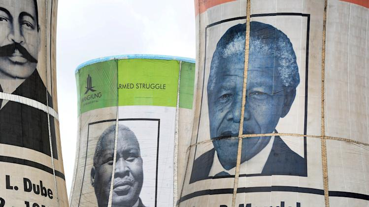Giant portraits of former African National Congress (ANC) presidents, including former South African President Nelson Mandela, right, overlook Bloemfontein, South Africa, Thursday, Dec 13, 2012. As South Africa's governing party moves closer to picking its next leader, it will do so without the man widely viewed as the country's moral compass, Mandela. Mandela, who remains hospitalized with a lung infection, led the African National Congress political party to victory in the nation's first truly democratic election in 1994 through a principled show of magnanimity toward the country's racist former rulers, despite spending nearly three decades in prison. On left is founding president John Dube and center is Albert Lethule. (AP Photo)