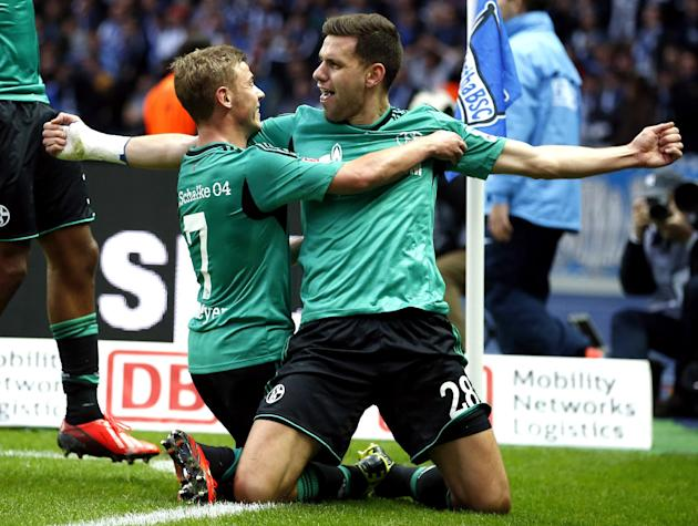Schalke's scorer Adam Szalai of Hungary, right, and his teammate Max Meyer, left, celebrate their side's opening goal during the German first division Bundesliga soccer match between Hertha BSC Berlin