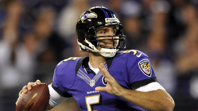 Baltimore Ravens quarterback Joe Flacco throws against the New England Patriots during the first half of an NFL football game in Baltimore, Sunday, Sept. 23, 2012. (AP Photo/Gail Burton)