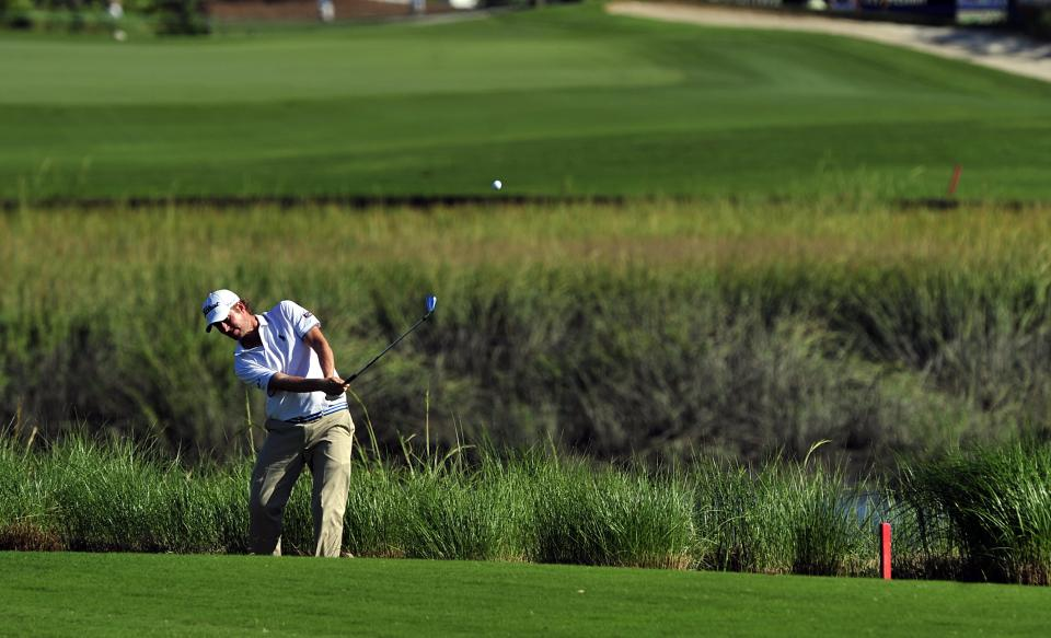 Webb Simpson hits out of the rough on the 13th fairway during the second round of the McGladrey Classic golf tournament at the Sea Island Golf Club on St. Simons Island, Ga., Friday, Oct. 14, 2011. (AP Photo/Stephen Morton)