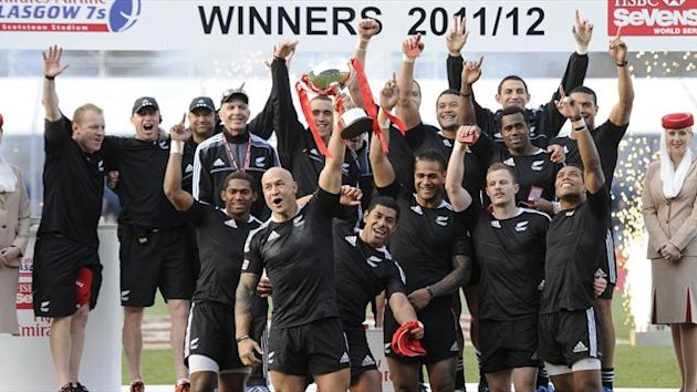 New Zealand players lift the trophy after defeating England in the final of the IRB Glasgow Sevens rugby tournament at Scotstoun Stadium in Glasgow