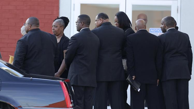 Family members leave a memorial service for Kansas City Chiefs' Jovan Belcher at the Landmark International Deliverance and Worship Center Wednesday, Dec. 5, 2012 in Kansas City, Mo. Belcher shot his girlfriend, Kasandra Perkins, at their home Saturday morning before driving to Arrowhead Stadium and turning the gun on himself.  (AP Photo/Ed Zurga)