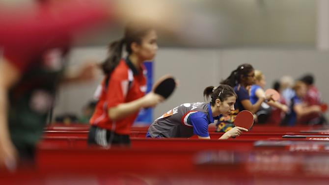 Athletes compete in qualification round at the World Team Table Tennis Championships in Suzhou