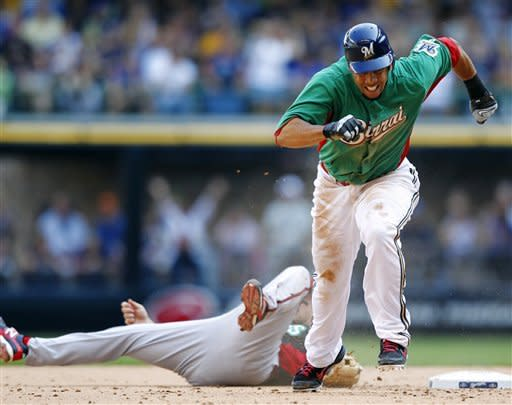 Gomez scores on 2 throwing errors, Brewers win 2-1