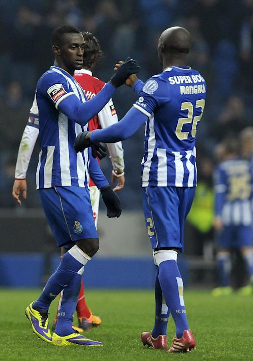 FC Porto's winning goal scorer Jackson Martinez, left, from Colombia is congratulated by fellow team member Eliaquim Mangala, from France, during a Portuguese League soccer match with Sporting Bra