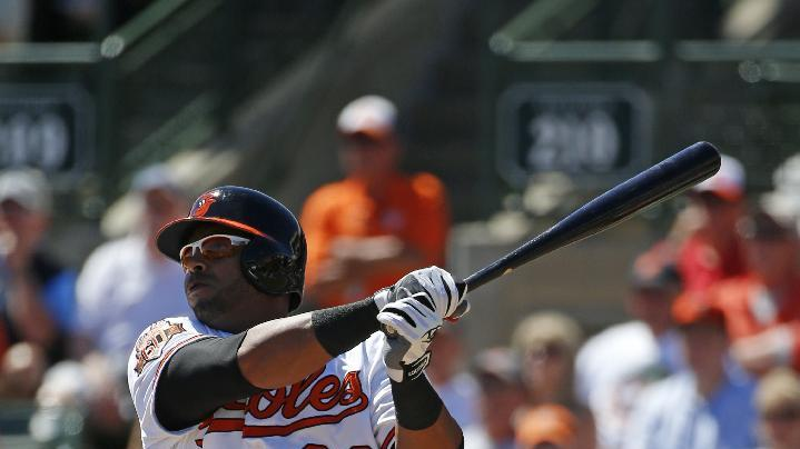 Baltimore Orioles' Nelson Cruz doubles off Boston Red Sox starting pitcher Henry Owens in the second inning of an exhibition spring training baseball game in Sarasota, Fla., Saturday, March 8, 2014. (AP Photo/Gene J. Puskar)