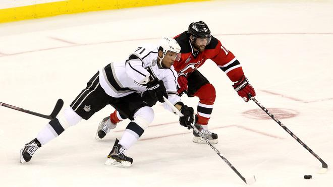 Jordan Nolan #71 Of The Los Angeles Kings And Stephen Gionta #11 Of The New Jersey Devils Go For A Loose Puck  Getty Images