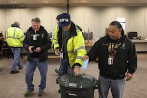 Union members cast their ballots at the International Association of Machinists District 751 Headquarters during a union vote in Seattle