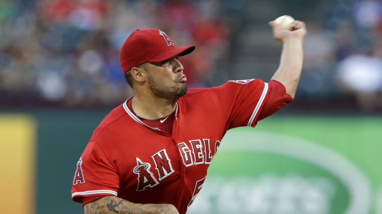 Los Angeles Angels starting pitcher Hector Santiago works against the Texas Rangers in the first inning of a baseball game, Thursday, July 10, 2014, in Arlington, Texas. (AP Photo/Tony Gutierrez)
