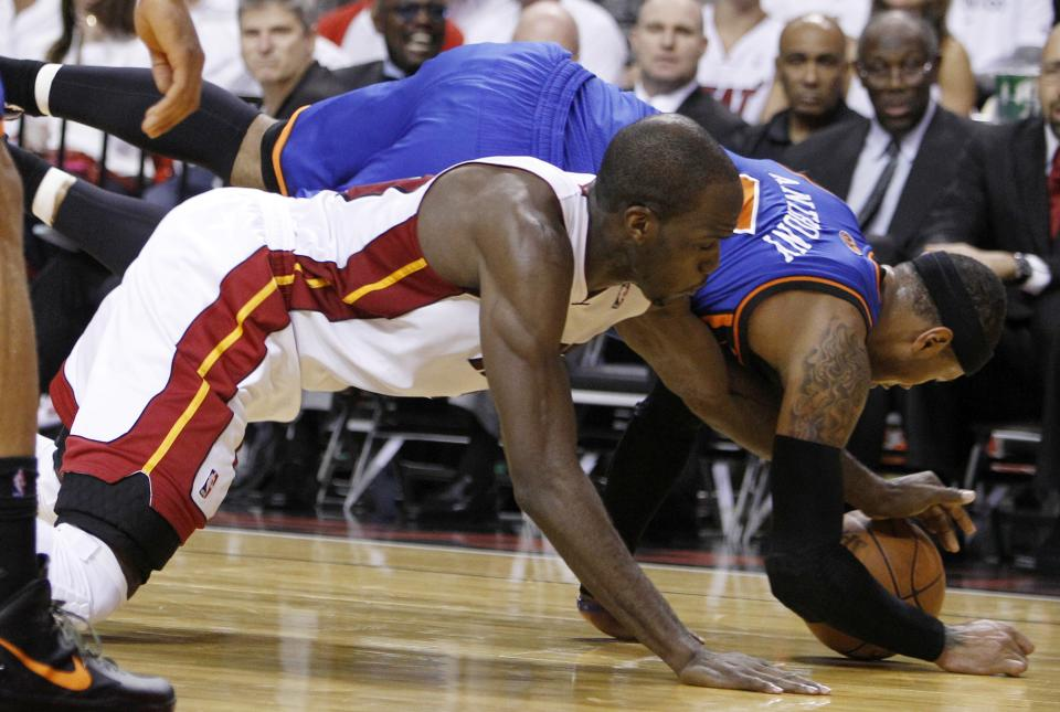 Miami Heat's Joel Anthony, left, and New York Knicks' Carmelo Anthony, right, fight for the ball in the first half of an NBA basketball game in the first round of the Eastern Conference playoffs in Miami, Monday, April 30, 2012. (AP Photo/Lynne Sladky)