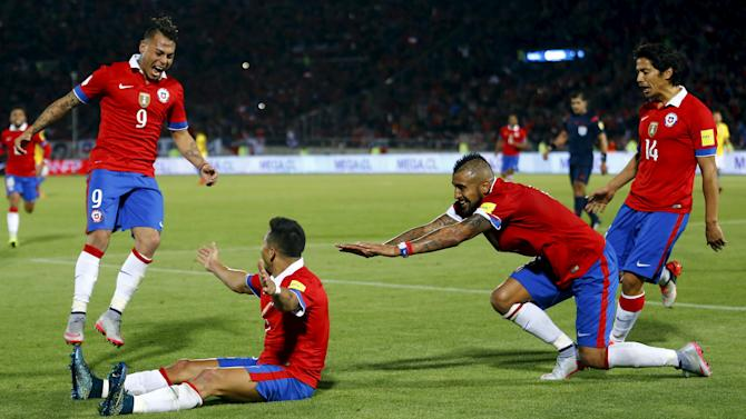 Sanchez of Chile celebrates with team mates Vargas, Vidal and Fernandez after scoring against Brazil during their 2018 World Cup qualifying soccer match in Santiago