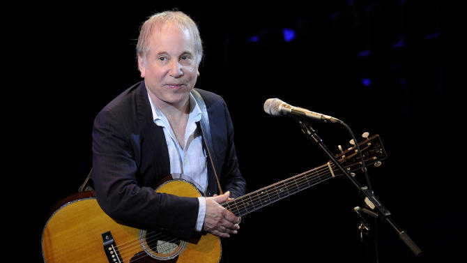 """FILE - In a Monday, April 2, 2012 file photo, singer Paul Simon performs at """"A Celebration of Paul Newman's Dream"""" to benefit """"SeriousFun"""" an association of Hole in the Wall Camps at Avery Fisher Hall in New York. Stephen Sondheim and Simon made a joint stage appearance Tuesday night, Dec. 3, 2013, at a small auditorium in downtown Manhattan. Their one-hour conversation was sponsored by the MacDowell artist colony. (AP Photo/Evan Agostini, File)"""