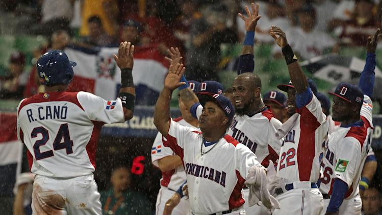 Dominican Republic's Robinson Cano, left, celebrates with teammates after scoring on a single by teammate Nelson Cruz in the first inning of the World Baseball Classic first round game against Venezuela in San Juan, Puerto Rico, Thursday, March 7, 2013. (AP Photo/Dennis M. Rivera Pichardo)