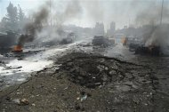 Vehicles burn near a crater on a road after an explosion at central Damascus February 21, 2013, in this handout photograph released by Syria&#39;s national news agency SANA. The big explosion shook the central Damascus district of Mazraa on Thursday, residents said, and Syrian state media blamed what it said was a suicide bombing on &quot;terrorists&quot; battling President Bashar al-Assad. REUTERS/Sana