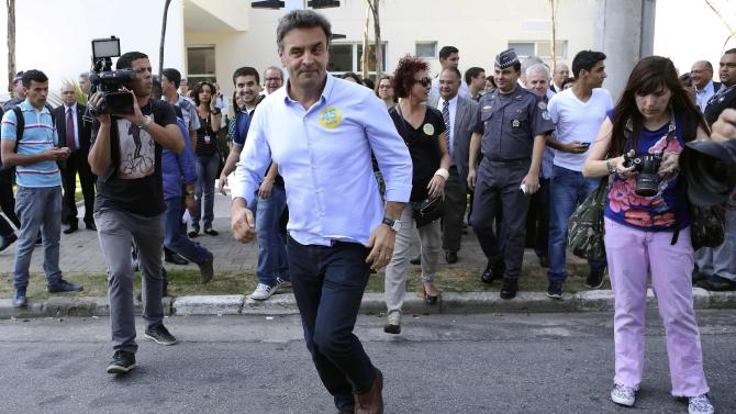 File photo of pesidential candidate Neves of PSDB running on a street during his campaign rally in Sao Paulo