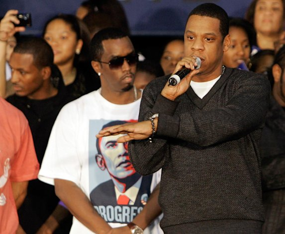 FILE - This Nov. 2, 2008 file photo shows Jay-Z, right, speaking to Sen. Barrack Obama, D-Ill., supporters as Diddy, center, and Russell Simmons, left, look on during a campaign rally for then-Democratic presidential candidate Sen. Barack Obama in Miami. President Barack Obama's re-election campaign is getting a boost from pop stars Beyonce and Jay-Z. The superstar couple will hold a fundraiser with Obama on Tuesday at a swanky New York nightclub that Jay-Z owns. (AP Photo/Alan Diaz, File)