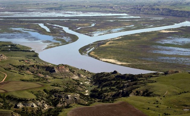 The Missouri River winds through the countryside near Williston, N.D. (AP Photo/Charles Rex Arbogast)