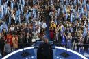 The Latest: Obama, Clinton embrace on stage at convention
