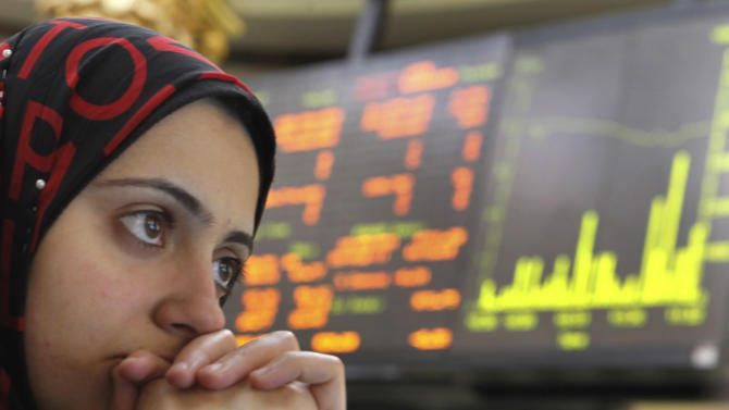 An Egyptian trader reacts after trading was halted for 30 minutes on the Egyptian Exchange after the benchmark index fell 5 percent, tracking a plunge in other world markets at the stock market, in Cairo, Egypt, Tuesday, Aug. 9, 2011. The Egyptian Exchange's benchmark index plunged, with investors taking their cues from other international markets taking a beating on fears that the downgrade in the U.S.'s credit rating could trigger a new global recession. (AP Photo/Amr Nabil)