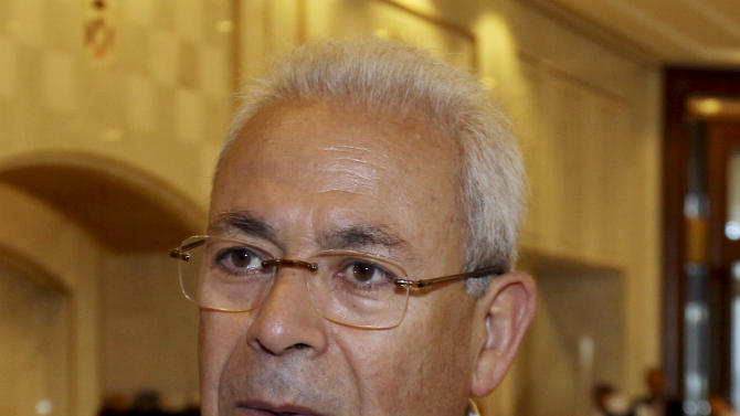 Syrian regime opponent Burhan Ghalioun attends the Election of the Executive Office of the Syrian National Council in Doha, Qatar, Friday, Nov. 9, 2012. (AP Photo/Osama Faisal)