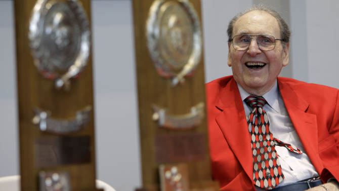 FILE - In this April 1, 2011, file photo, former University of Houston basketball coach Guy V. Lewis looks on with two of his five NCAA Final Four trophies during a reception held in his honor at the school in Houston. Elvin Hayes hasn't visited the Naismith Basketball Hall of Fame since his induction in 1990, and he turns down invitations to attend special events affiliated with it. The former University of Houston star will only end his boycott to see his Lewis, college coach enshrined, but there's no guarantee that day will ever come. (AP Photo/Charlie Neibergall, File)