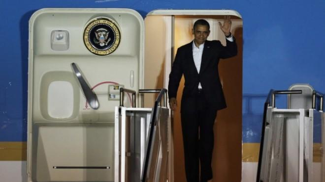 "President Obama arrives at Palm Beach International Airport on Feb. 15 to begin his ""secret"" vacation."