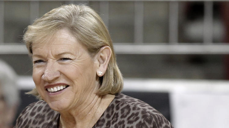 North Carolina coach Sylvia Hatchell, smiles at a player before North Carolina's NCAA college basketball game against Boston College in Boston on Thursday, Feb. 7, 2013. (AP Photo/Winslow Townson)