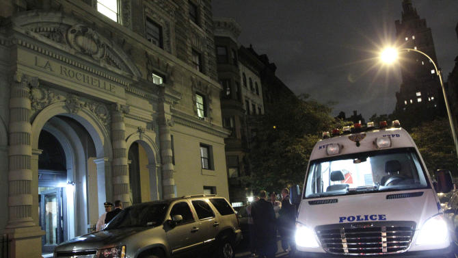 A police crime scene vehicle is parked in front of the luxury Manhattan apartment building where police say a nanny stabbed two small children to death in a bathtub and then stabbed herself in New York, Thursday, Oct. 25, 2012. Police say the children's mother found the scene after returning home with another child. (AP Photo/Kathy Willens)