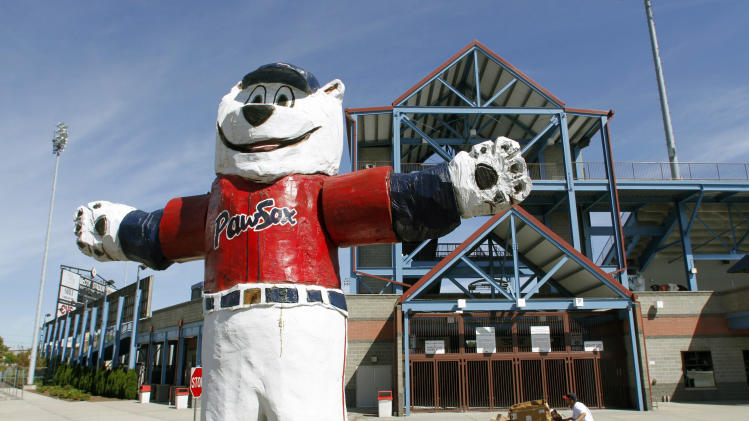 "In this Sept. 23, 2010 photo, a statue of the Pawtucket Red Sox baseball team mascot ""Paws"" stands outside McCoy Stadium, in Pawtucket, R.I.  Fans of the show, based in the fictional Rhode Island town of Quahog, can hit the road on a bus tour highlighting a dozen sites in the state that have served as inspiration. (AP Photo/Steven Senne)"