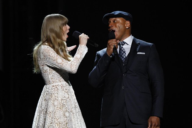 Hosts Taylor Swift, left, and LL Cool J sing onstage at the Grammy Nominations Concert Live! at Bridgestone Arena on Wednesday, Dec. 5, 2012, in Nashville, Tenn. (Photo by Wade Payne/Invision/AP)