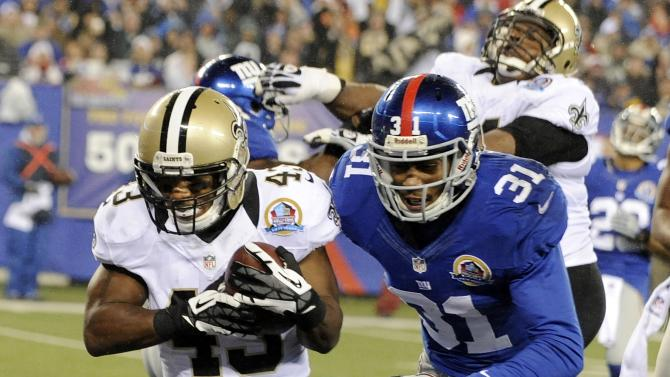 New Orleans Saints running back Darren Sproles (43) scores on a 13-yard touchdown run ahead of New York Giants defensive back Will Hill (31) during the second half of an NFL football game, Sunday, Dec. 9, 2012, in East Rutherford, N.J. (AP Photo/Bill Kostroun)