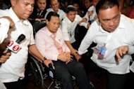 Philippines Chief Justice Renato Corona (in wheelhair) is escorted by security personnel as he leaves the Senate after testifying at his impeachment trial in Manila. The Philippines' top judge denied he was a crook as he testified then dramatically walked out at his own trial Tuesday, denouncing his impeachment as a personal vendetta by President Benigno Aquino