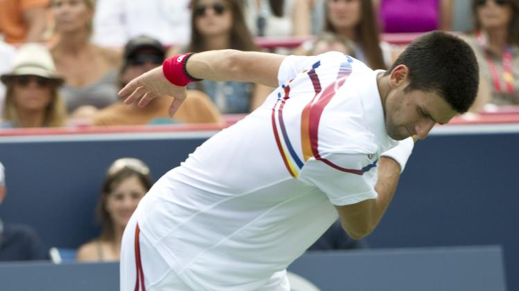 Novak Djokovic, from Serbia, slams his racket during during the men's final against Mardy Fish, from the United States, at the Rogers Cup tennis tournament on Sunday, Aug. 14, 2011, in Montreal. Novak Djokovic won 6-2, 3-6, 6-4. (AP Photo/The Canadian Press, Paul Chiasson)