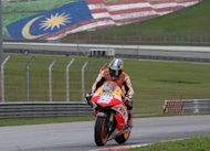Honda&#39;s Dani Pedrosa approaches a turn during a pre-season MotoGP test session at the Sepang circuit outside Kuala Lumpur on February 28, 2013. Pedrosa has set the pace on the final day of the second MotoGP test at Sepang in Malaysia, while his new teammate Marc Marquez took second on a slippery circuit