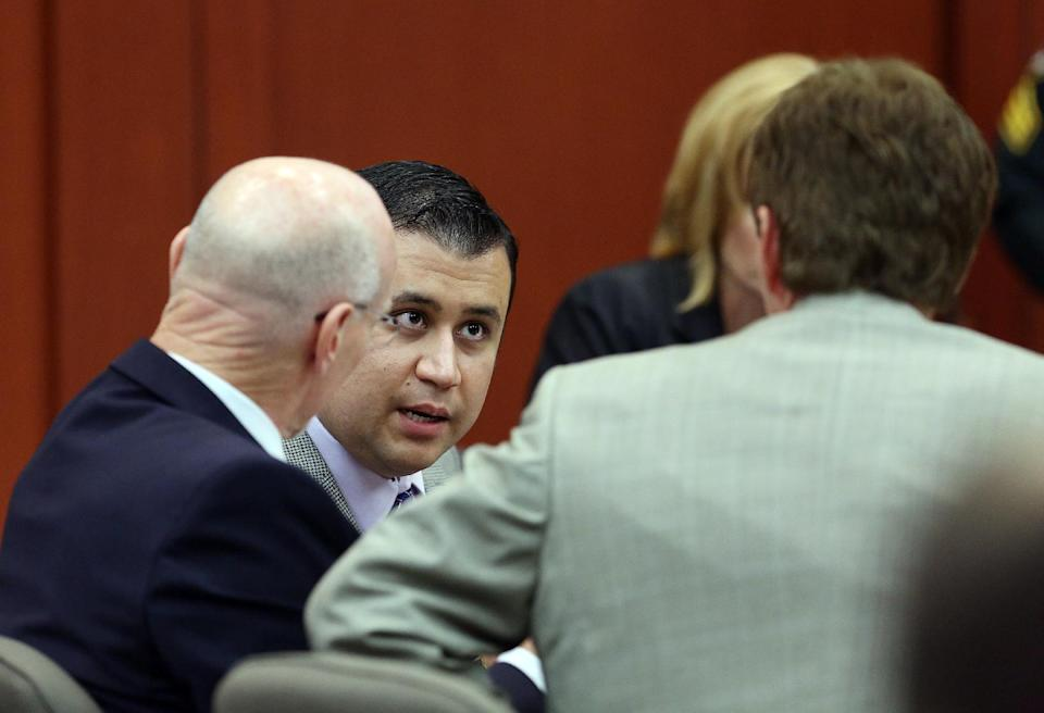 George Zimmerman, center, talks to his defense team during his trial in Seminole circuit court in Sanford, Fla. Thursday, June 27, 2013. Zimmerman has been charged with second-degree murder for the 2012 shooting death of Trayvon Martin. (AP Photo/Orlando Sentinel, Jacob Langston, Pool)