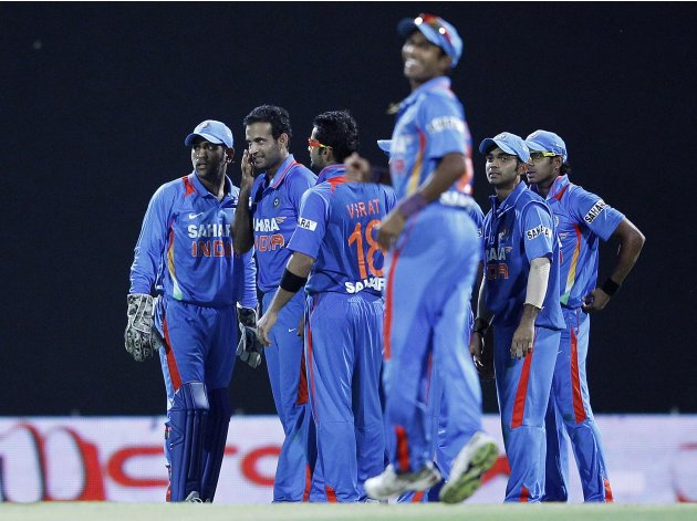 India's cricketers celebrate taking the wicket of Sri Lanka's tharanga during the Twenty20 match in Pallekele