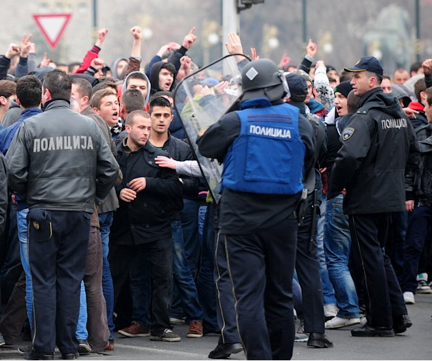 A group of ethnic Albanians confront the police during a protest through a street in Skopje, Macedonia, on Saturday, March 2, 2013, as they show their support for newly named defence minister Talat Xh