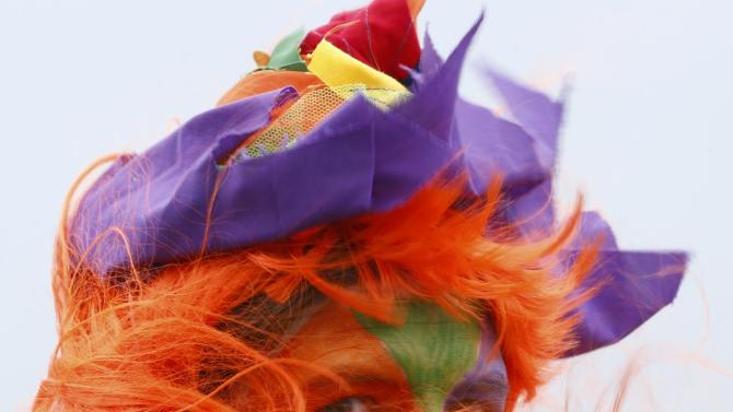Carnival reveller braves the wind and rain after after Rosenmontag parade cancelled in Duesseldorf